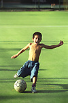 Young football fan a child Buenos Aires Argentina South America. 2000s 2002