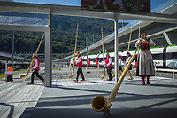 "Switzerland. Canton Ticino. Camorino. Ceneri Base Tunnel (CBT). Official opening ceremony with traditional Swiss Alphorn players. Alphorn is long wooden musical instrument. The alphorn or alpenhorn or alpine horn is a labrophone, consisting of a straight several-meter-long wooden natural horn of conical bore, with a wooden cup-shaped mouthpiece. It is used by mountain dwellers in the Swiss Alps. The Ceneri Base Tunnel (CBT) (Italian: Galleria di base del Monte Ceneri) is a railway base tunnel in Canton Ticino. It passes under Monte Ceneri between Camorino in the Magadino Flat and Vezia near Lugano, and bypasses the former high-altitude rail route through the Monte Ceneri Tunnel. It is composed of two single-track tunnels, each 15.4 km long. It is another part of the New Railway Link through the Alps (NRLA) project. The impact will be significant on international traffic with shorter time trips. The opening of the Ceneri tunnel also means a transport revolution for the southern canton of Ticino. Regional rail lines will be upgraded, and some reckon the change could lead to the creation of a ""Ticino City"" – one big urban sprawl across the canton. 4.09.2020  © 2020 Didier Ruef"