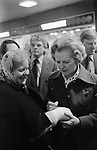 Margaret Thatcher campaigning for the 1979 General Election in Northampton.  She is signing the plaster cast of a local Tory supporter.
