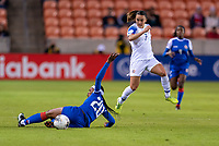 HOUSTON, TX - JANUARY 31: Kethna Louis #20 of Haiti tackles the ball away from Melissa Herrera #7 of Costa Rica during a game between Haiti and Costa Rica at BBVA Stadium on January 31, 2020 in Houston, Texas.