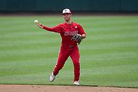North Carolina State Wolfpack second baseman J.T. Jarrett (15) makes a throw to first base against the North Carolina Tar Heels at Boshamer Stadium on March 27, 2021 in Chapel Hill, North Carolina. (Brian Westerholt/Four Seam Images)