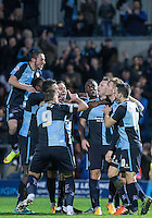 Celebrations following Garry Thompson of Wycombe Wanderers opening goal during the Sky Bet League 2 match between Wycombe Wanderers and Oxford United at Adams Park, High Wycombe, England on 19 December 2015. Photo by Andy Rowland.