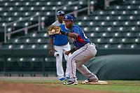 AZL Rangers first baseman Stanley Martinez (29) receives a throw during an Arizona League game against the AZL Cubs 2 at Sloan Park on July 7, 2018 in Mesa, Arizona. AZL Rangers defeated AZL Cubs 2 11-2. (Zachary Lucy/Four Seam Images)
