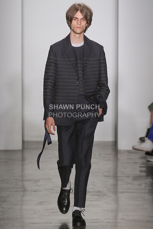 Model walks runway in an outfit by Shih Hsun Lee for the Parsons MFA fashion show, during New York Fashion Week Spring 2016.