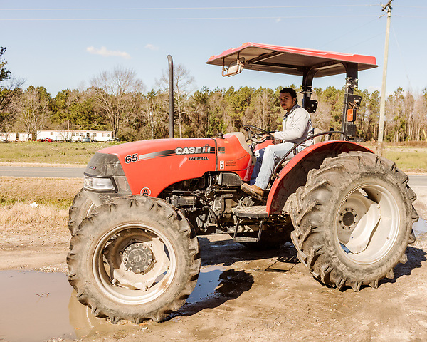 December 30, 2016. Rose Hill, North Carolina.<br /> <br /> John Dunn drives a tractor along a road near his home.<br />  <br /> John Dunn, age 19, is currently a freshman at NC State University and is the first person in his family to go to college. With a combination of grants, loans, help from his grandfather and weekend farm work, Dunn hopes to find finish college and find a career in agriculture.<br /> <br />  Colleges and universities, which are always trying to pinpoint an under-served and sometimes underprivileged populations of students, have noted a decline in students from rural areas of the country. There are various efforts underway in colleges and universities to identify more of these kids and get them enrolled.