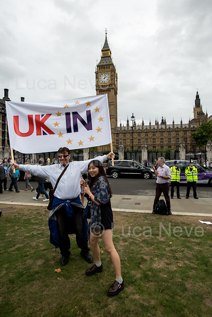 """London, 03/09/2016. Today, thousands people marched peacefully from Park Lane to Parliament Square to protest against the EU Referendum result (Turnout 72.2%: 51,9% to leave the EU, 17,410,742 Votes, versus 48,1% to remain in the EU, 16,141,241 Votes) and to show that Great Britain is still part of Europe. Protestors of all ages were present in significant numbers representing all the generations of the British population. The aim of the protest was to call the Conservative Government, lead by Theresa May, not to invoke the Article 50 which will quickly activate the exit of Great Britain from the EU, also know as Brexit. When the march arrived outside Down Street a small group of """"Brexit activists"""" were holding a counter demo pro-Leave the EU. In the meantime, a man with a bandana covering his face stole Eddie Izzard pink beret. Police officers promptly arrested the protester and recover Mr Izzard hat. From the organiser Facebook page: <<On Saturday 3rd September we are coming together in great numbers to #marchforeurope. A creative show of passion will take place with hundreds of thousands of people protesting in multiple cities across the country, and with London's demonstration congregating outside the Houses of Parliament. Two days later Parliament will reconvene to debate Britain's future with Europe, and we want to make our message heard - Britain is better in Europe […]>>. Similar demonstrations were held in Cardiff, Birmingham, Edinburgh, Bristol, Oxford, Cambridge.<br /> <br /> For more information please click here: https://www.facebook.com/events/1740541299568402/<br /> <br /> For the reportage """"EU Referendum - The United Kingdom Leaves the European Union"""" please click here: http://bit.ly/2aBpGSG"""