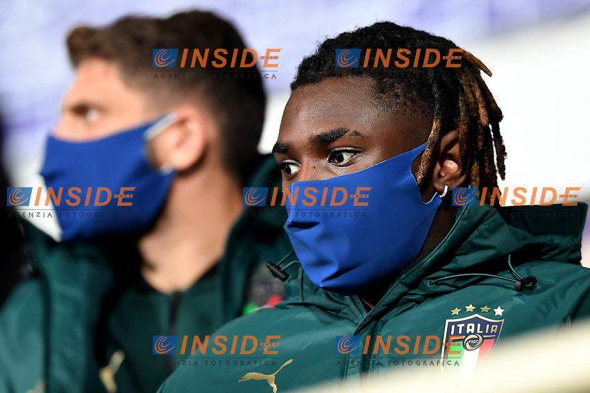 Moise Kean of Italy, wearing a mask, attends from the tribune the friendly football match between Italy and Estonia at Artemio Franchi Stadium in Firenze (Italy), November, 11th 2020. Photo Andrea Staccioli/ Insidefoto