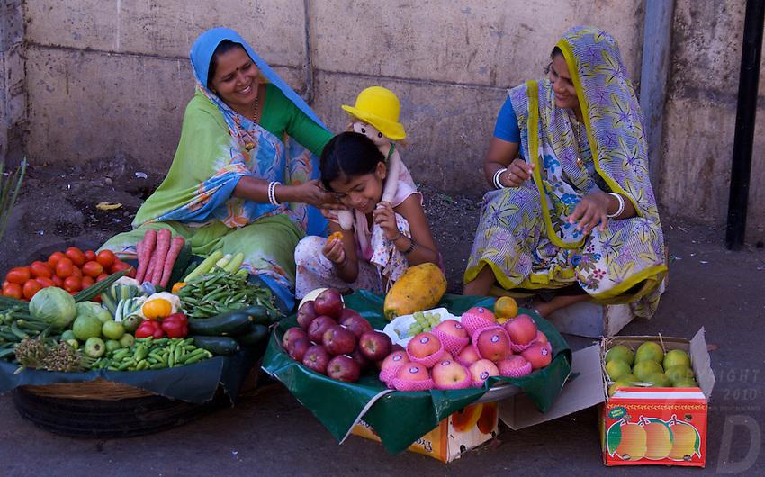 Mumbai, Vendors selling fruit on the street in the Banganga area,India