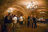 Wine tasting in the underground cellar at CASTELLO DI AMAROSA, a WINERY housed by an authentic but recently constructed ITALIAN CASTLE located near CALISTOGA - NAPA VALLEY, CALIFORNIA