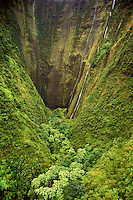 A spectacular waterfall winds down a remote mountain on the lush Hamakua coast near North Kohala.