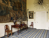 The walls of many of the public rooms are hung with tapestries and floors laid with tartan carpet