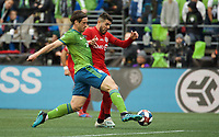 SEATTLE, WA - NOVEMBER 10: Seattle Sounders defender Gustav Svensson #4 defends during a game between Toronto FC and Seattle Sounders FC at CenturyLink Field on November 10, 2019 in Seattle, Washington.
