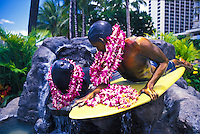 The Makua and Kila statues adorned with flower leis on the Waikiki Historic Trail.