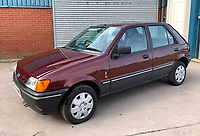 BNPS.co.uk (01202 558833)<br /> Pic: HampsonAuctions/BNPS<br /> <br /> Pictured: 1990 Ford Fiesta 1.4 Ghia.<br /> <br /> Since the 1990s, Geoff Barlow, 46, has collected dozens of classic cars from an Escort Mexico replica to several types of Transit, Cortina, and Sierra.<br /> <br /> However, he still regrets selling the first car which inspired his passion, a 1980 Escort Mark 2 he bought from his sister in 1992.  <br /> <br /> Geoff's fascination with Fords gathered pace in the last decade and he 'lost control,' buying as many Fords as he came across and saving them from disrepair.