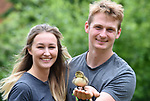 Pictured:  Will Hall and Alice Kendall with the duckling.<br /> <br /> A couple have become the unexpected owners of a duckling after finding an abandoned egg - and hatching it in their oven.  Heartwarming photographs and videos show the days-old duckling following Will Hall and Alice Kendall around their home after they rescued it, even 'terrifying' their big German pointer, Meg.<br /> <br /> Mr Hall, a teacher at leading independent school Winchester College, discovered the duck egg while out walking in a grassy area on Saturday and couldn't find its nest.  Not wanting to leave the egg, the 26 year old FaceTimed his events coordinator partner and the pair hatched a plan to save it.<br /> <br /> Miss Kendall, 22, preheated the oven at their home in Winchester, Hants, ready for their arrival, setting up a makeshift incubator by placing a tea towel on a baking tray.  SEE OUR COPY FOR DETAILS.<br /> <br /> © Simon Czapp/Solent News & Photo Agency<br /> UK +44 (0) 2380 458800