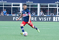 FOXBOROUGH, MA - JULY 25: Carles Gil #22 of New England Revolution takes a shot on goal during a game between CF Montreal and New England Revolution at Gillette Stadium on July 25, 2021 in Foxborough, Massachusetts.