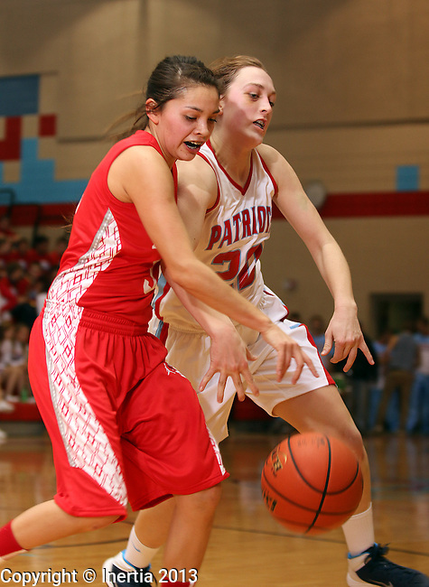 SIOUX FALLS, SD: DECEMBER 13: Izzy VanVeldhuizen #20 from Lincoln battles for the ball with Caitlyn Shoulder #3 from Rapid City Central in the first half of their game Friday night at Lincoln High. (photo by Dave Eggen/Inertia)