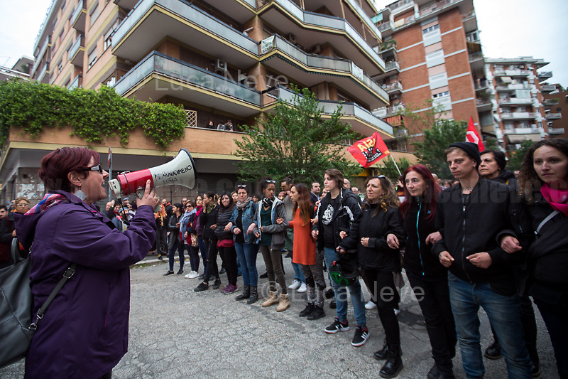 """Resident who fights for Housing Rights and against evictions.<br /> <br /> Antifascists.<br /> <br /> Roma, 08/05/2019. Today, members of the far-right/neo-fascist political party 'casapound', held a rally in Casal Bruciato (suburb in the East side of Rome) in response to the allocation of a council flat to a Roma family - legally in the waiting list of Rome's Municipality - with twelve children and not any previous offenses committed. On the 7th of May a similar protest was held with the support of some residents of the district. Some members of the fascist organization 'casapound', undisputed by the police, insulted and menaced the Roma woman - while she was carrying her daughter in her arms - to """"rape"""" her, that she is a """"prostitute"""", and that all Roma people should be """"hanged"""".<br /> In the meantime, Anti-fascist / Anti-racist Organizations, Movements for Housing, social centres, members of the public, supported by trade unions and lefty political parties, held a counter-demonstration nearby. The demo was called to protest against the rally of """"casapound"""", accused to be a fascist group (illegal for the Italian Law so which needs to be immediately closed) - they call themselves """"fascists of the third millennium"""" - trying to fomenting hatred, pushing the people of the suburbs in a war between poor people, and to be just """"narrow-minded slander"""" ('sciacallaggio' in Italian).  <br /> The heavy police presence in full riot gears, supported by a water cannon truck and a helicopter, kept the two sides apart letting the Antifascist movements having a march in the district, once a historic """"Roccaforte Rossa"""" (a red stronghold)."""
