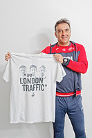 "Pictured: Manager Carlos Carvalhal holding one of the t-shirts. Tuesday 27 March 2018<br /> Re: New Swansea City FC t-shirts with messages like ""All The Meat on the Barbecue"" and 4pm London Traffic"" at the Fairwood Training Ground near Swansea, Wales, UK"