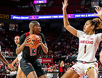 COLLEGE PARK, MD - FEBRUARY 9: Shakira Austin #1 of Maryland defends against Mael Gilles #13 of Rutgers during a game between Rutgers and Maryland at Xfinity Center on February 9, 2020 in College Park, Maryland.