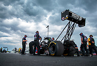 Jul 11, 2020; Clermont, Indiana, USA; Crew members stand alongside the dragster of NHRA top fuel driver Antron Brown during qualifying for the E3 Spark Plugs Nationals at Lucas Oil Raceway. This is the first race back for NHRA since the start of the COVID-19 global pandemic. Mandatory Credit: Mark J. Rebilas-USA TODAY Sports
