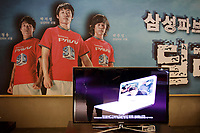 SOUTH KOREA. Inside the main showroom of Samsung, at their head-office in downtown Seoul. Park Ji-Sung, the Manchester United Korean player stands (center) in a advertisement on the wall. 2010