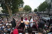 Protestors from a range of left wing and LGBT groups march from Russell square to Downing listening to music and speeches from a bus. The demonstration was against the appointment of Boris Johnson as Prime Minister. London 24-7-19
