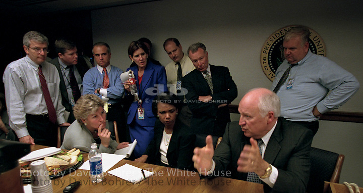 """RC:  PEOC room meetings on day of terrorist attacks.  RESTRICTED: DO NOT PRINT WITHOUT APPROVAL OF DAVID BOHRER..Immediately after the Sept. 11 terrorist attacks, Vice President Dick Cheney and senior staff gathered in the President's Emergency Operations Center. White House staff collected and discussed information as the day unfolded and they kept in contact with the President.  Photographed are Counselor Karen Hughes (seated left), National Security Advisor Dr. Condoleezza Rice (seated right), Deputy Chief of Staff Josh Bolten (far left), Director of Media Affairs Tucker Eskew, Assistant to the President Nick Calio, Counselor to the Vice President Mary Matalin, Chief of Staff for the Vice President Lewis Libby, and Director of the National Economic Council Larry Lindsey (right)...Released (to Washington Post 6.6.07): Vice President Dick Cheney and senior staff gather in the Presidential Emergency Operations Center immediately following the terrorist attacks Sept. 11, 2001. Photographed are Counselor Karen Hughes (seated left), National Security Advisor Dr. Condoleezza Rice (seated right), Deputy Chief of Staff Josh Bolten (far left), Director of Media Affairs Tucker Eskew, Assistant to the President Nick Calio, Counselor to the Vice President Mary Matalin, Chief of Staff for the Vice President Lewis Libby, and Director of the National Economic Council Larry Lindsey (right). .WEB..Released to NIGHTLINE 111203, David Wargin, American Legislative Exchange Council and National Journal..Released to Bush/Cheney '04 for Mary Matalin interview with MSNBC 8.20.04..Released to National Geographic for a children's book """"Our Country's Presidents"""" 10.2.04..RELEASED TO: CBC TELEVISION CANADA.  . WEST WING JUMBO .WEB."""
