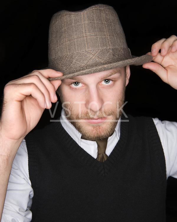 USA, Illinois, Peoria, Studio portrait of young man wearing hat