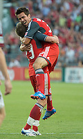 18 July 2012: Toronto FC forward Andrew Wiedeman #32 celebrates his goal with Toronto FC midfielder Terry Dunfield #23 during an MLS game between the Colorado Rapids and Toronto FC at BMO Field in Toronto..Toronto FC won 2-1..