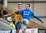 Motherwell v St Johnstone...31.01.15    SPFL<br /> Chris Kane is tackled by Craig Reid<br /> Picture by Graeme Hart.<br /> Copyright Perthshire Picture Agency<br /> Tel: 01738 623350  Mobile: 07990 594431