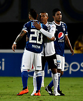 BOGOTÁ - COLOMBIA, 19-08-2018: Juan Guillermo Domínguez (Izq.), Cristian Marrugo (Der.) jugadores de Millonarios y MacNelly Torres (Cent.) jugador del Deportivo Cali, al final de partido de la fecha 5 entre Millonarios y Deportivo Cali, por la Liga Aguila II-2018, jugado en el estadio Nemesio Camacho El Campin de la ciudad de Bogota. / Juan Guillermo Dominguez (L), Cristian Marrugo (R) players of Millonarios and MacNelly Torres (C) player of Deportivo Cali, at the end of a match of the 5th date between Millonarios and Deportivo Cali, for the Liga Aguila II-2018 played at the Nemesio Camacho El Campin Stadium in Bogota city, Photo: VizzorImage / Luis Ramirez / Staff.
