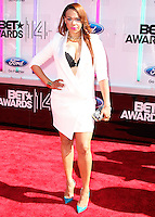 LOS ANGELES, CA, USA - JUNE 29: Singer Faith Evans arrives at the 2014 BET Awards held at Nokia Theatre L.A. Live on June 29, 2014 in Los Angeles, California, United States. (Photo by Xavier Collin/Celebrity Monitor)