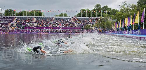 04 AUG 2012 - LONDON, GBR - Competitors start the swim at the women's London 2012 Olympic Games Triathlon in Hyde Park, London, Great Britain (PHOTO (C) 2012 NIGEL FARROW)