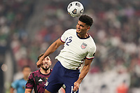 LAS VEGAS, NV - AUGUST 1: Miles Robinson #12 of the United States goes up for a header during a game between Mexico and USMNT at Allegiant Stadium on August 1, 2021 in Las Vegas, Nevada.