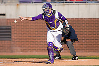 Jared Avchen #22 of the East Carolina Pirates tosses the ball back to the mound after the third out of the inning at Clark-LeClair Stadium on February 19, 2010 in Greenville, North Carolina.   Photo by Brian Westerholt / Four Seam Images