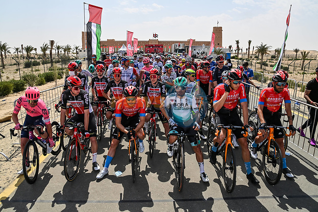 Lined up for the start of Stage 1 of the 2021 UAE Tour the ADNOC Stage running 176km from Al Dhafra Castle to Al Mirfa, Abu Dhabi, UAE. 21st February 2021.  <br /> Picture: LaPresse/Gian Mattia D'Alberto | Cyclefile<br /> <br /> All photos usage must carry mandatory copyright credit (© Cyclefile | LaPresse/Gian Mattia D'Alberto)