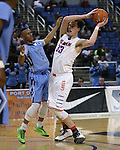 Canyon Springs' Gerad Davis and Bishop Gorman's Stephen Zimmerman compete in the Division I championship game in the NIAA basketball state tournament at Lawlor Events Center, in Reno, Nev., on Friday, Feb. 28, 2014. Bishop Gorman won the title 71-58. (Cathleen Allison/Las Vegas Review-Journal)
