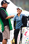 TAOYUAN, TAIWAN - OCTOBER 21: Ai Miyazato of Japan talks with her caddie on the 1st tee during day two of the LPGA Imperial Springs Taiwan Championship at Sunrise Golf Course on October 21, 2011 in Taoyuan, Taiwan. (Photo by Victor Fraile/Getty Images)