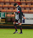 Pars' Faissal El Bakhtaoui heads for an early bath after receiving a straight red card for kicking out at Stranraer's Steven Bell.