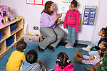Education preschool 3-4 year olds circle time small group with female teacher, counting activity- how many boys, how many girls