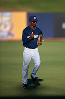 AZL Brewers Blue center fielder Terence Doston (9) jogs off the field between innings of an Arizona League game against the AZL Athletics Gold on July 2, 2019 at American Family Fields of Phoenix in Phoenix, Arizona. AZL Athletics Gold defeated the AZL Brewers Blue 11-8. (Zachary Lucy/Four Seam Images)