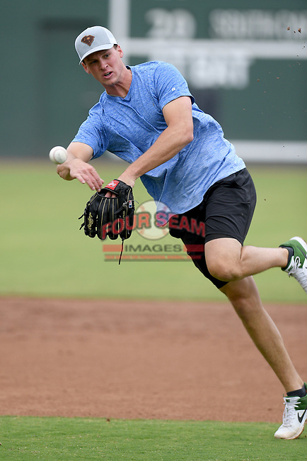 Logan Davidson of the Oakland Athletics works an infield drill with other Major League and Minor League players from around the region on Tuesday, June 16, 2020, at Fluor Field at the West End in Greenville, South Carolina, as team workouts remain shut down. Davidson was drafted out of Clemson. (Tom Priddy/Four Seam Images)
