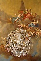 A crystal chandelier hangs from a ceiling painted by Francesco Martini and Carlo Zucchi