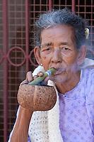 Myanmar, Burma.  Bagan Woman Smoking a Cigar.
