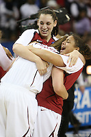 SACRAMENTO, CA - MARCH 29: Ashley Cimino and Grace Mashore celebrate with Kayla Pedersen after Stanford's 55-53 win over Xavier in the NCAA Women's Basketball Championship Elite Eight on March 29, 2010 at Arco Arena in Sacramento, California.