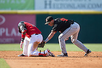 Yeyson Yrizarri (2) of the Hickory Crawdads slides into second base with a double ahead of the tag attempt by Drew Turbin (9) of the Delmarva Shorebirds at L.P. Frans Stadium on June 18, 2016 in Hickory, North Carolina.  The Crawdads defeated the Shorebirds 1-0 in game one of a double-header.  (Brian Westerholt/Four Seam Images)