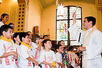 """Children and parents attend mass before the """"Dancing of the Children's Giglio"""" on July 7, 2006."""