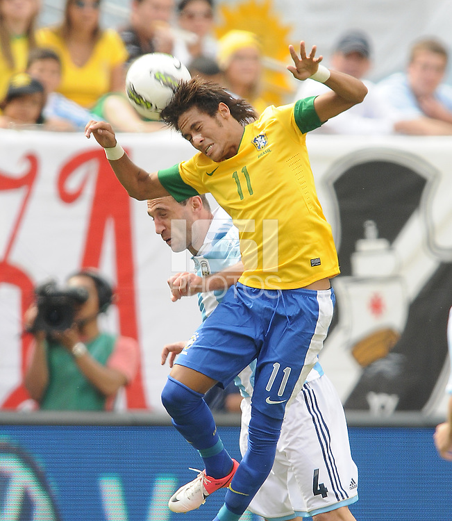 Brazil forward Neymar (11) heads the ball against Argentina defender Pablo Zabaleta (4) The Argentina National Team defeated Brazil 4-3 at MetLife Stadium, Saturday July 9 , 2012.