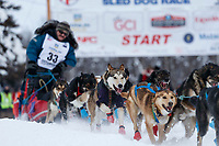 Ed Hopkins dogs charge down the chute during the restart of the 2019 Iditarod race in Willow, Alaska.<br /> <br /> Photo by Jeff Schultz/  (C) 2019  ALL RIGHTS RESERVED